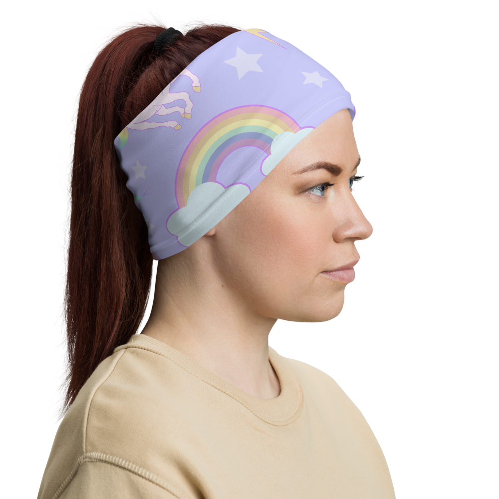 Lavender unicorns and rainbows print face and neck cover worn as a headband (side view)