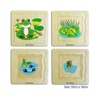 4 layer wooden puzzle following a frog's development from egg, through tadpole all the way to adult frog on a lily pad through the layers of this puzzle.