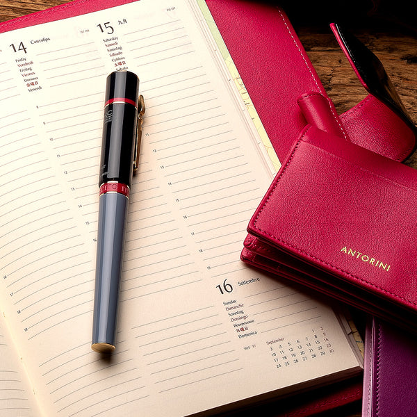 Multifunctional Leather A5 Journal and Notepad in Black Patent & Fuchsia