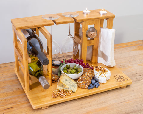 The ultimate cheese board. An all in one wine and cheese board by Lux Lane.  A bamboo board that holds two bottles of wine, two glasses, two candles, toothpicks, napkins and room for your cheeses. Made from high qulality durable mosso bamboo.