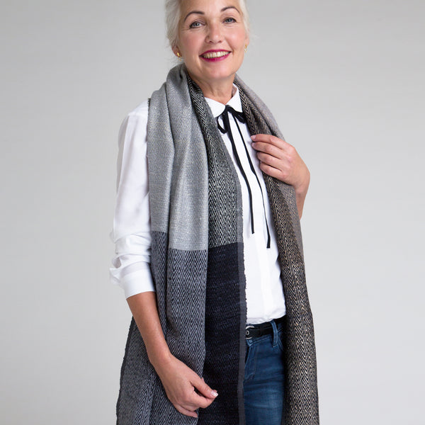 Model Jeanine is wearing the shawl neutral handmade by 15 artisans using fine natural materials.