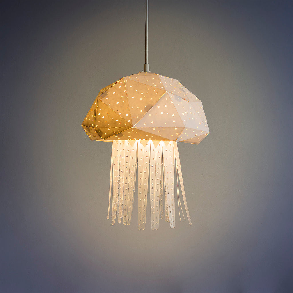 Pendant geometric lamp in the form of Jellyfish, the light is on.