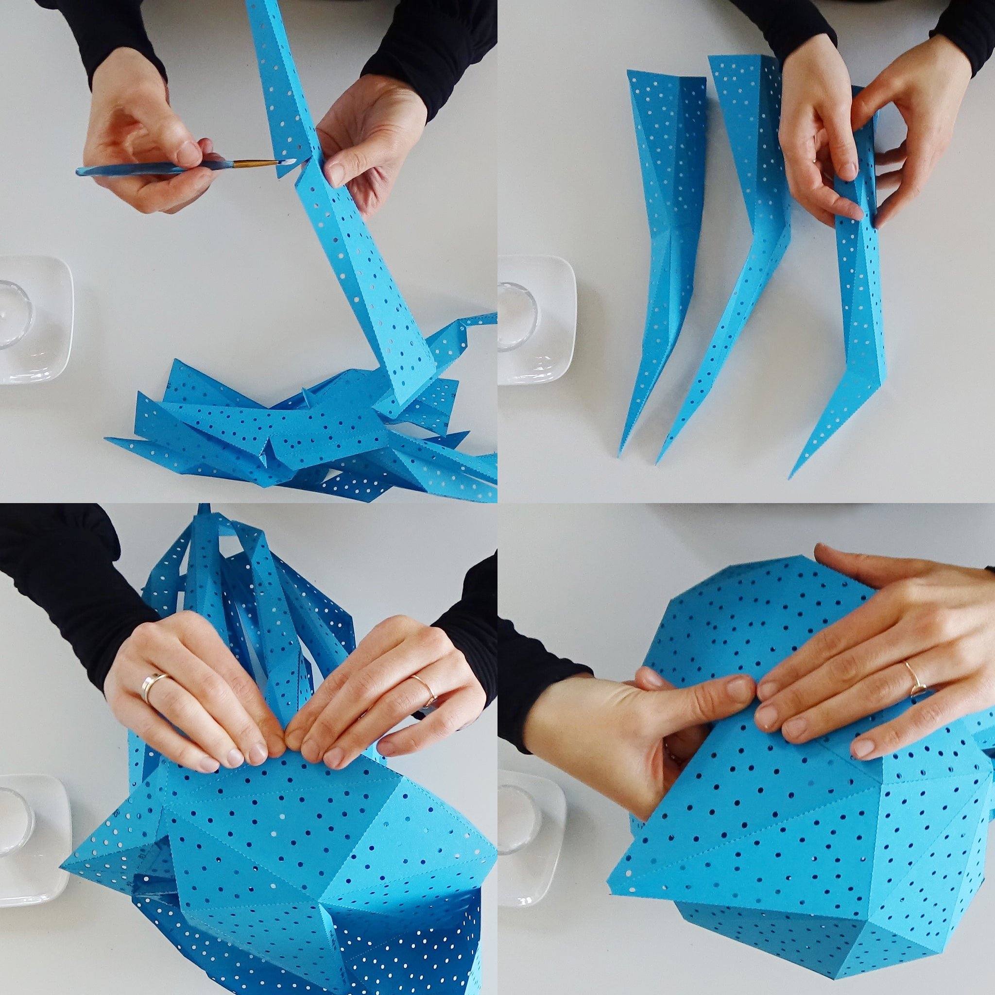 Woman's hands fold and glue the blue jellyfish lantern from the pre-cut templates.