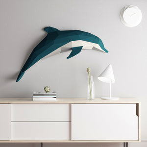 The the 3D paper sculpture Dolphin decorates the grey wall in a living room.