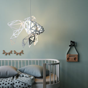 There is a nursery with white lampshade in the form of Fish hanging above kids bed.