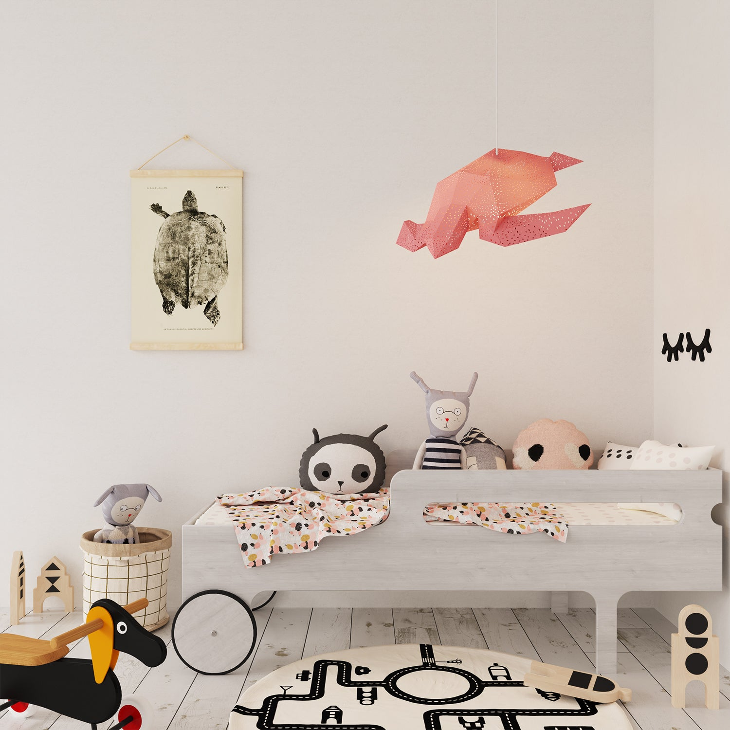 There is the pink Sea Turtle lantern hanging in a kids' room with bed, carpet and a poster on the wall.