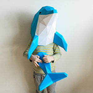 Boy holding paper sculpture of Dolphin