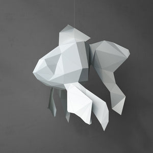 DIY Papercraft Goldfish on a dark background.