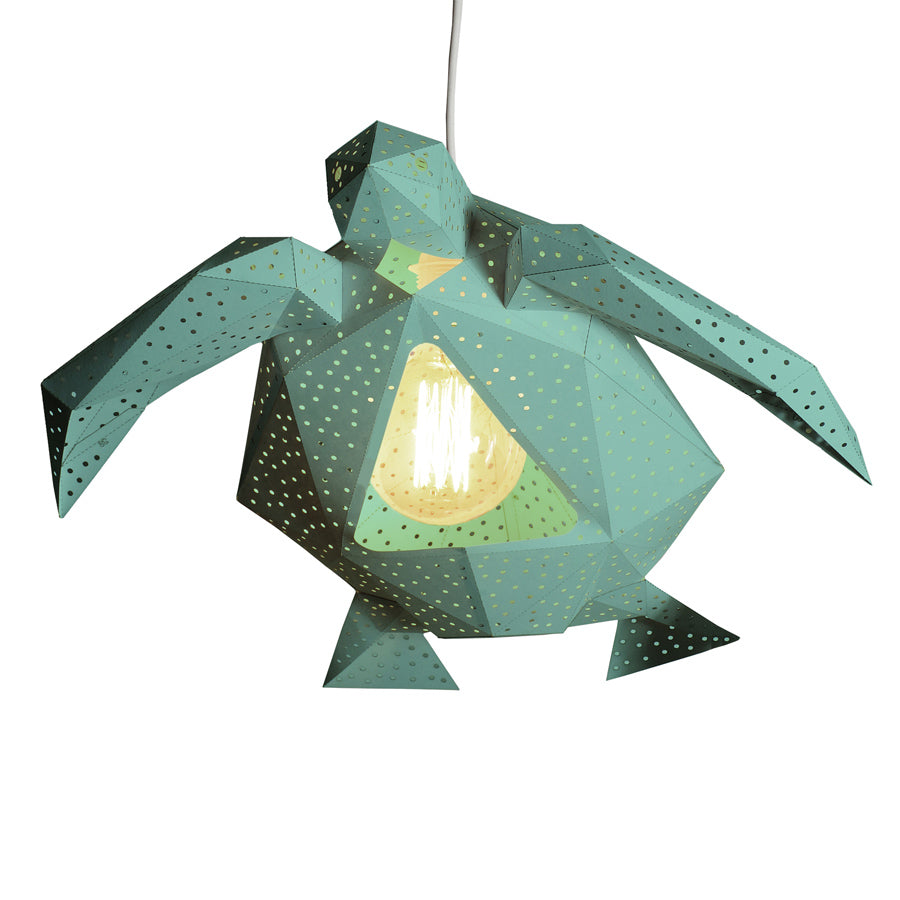 DIY green paper Sea Turtle lantern on white background.