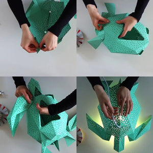 Woman's hands fold and glue the green Sea Turtle lantern from the pre-cut templates.
