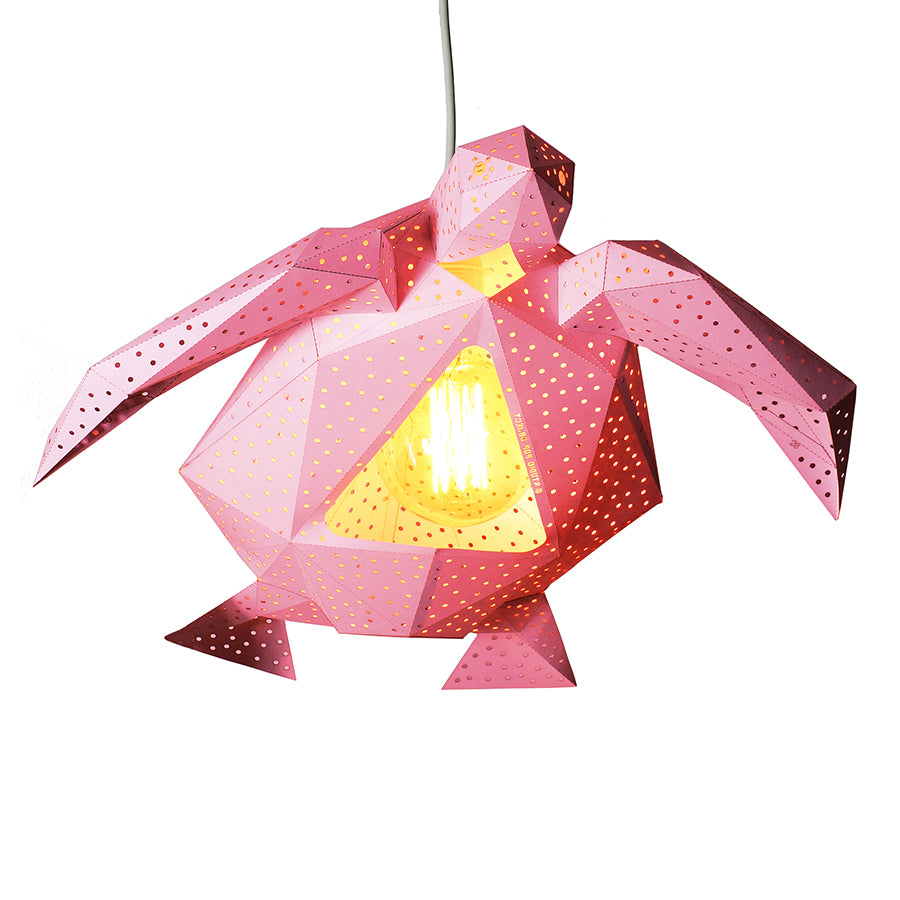 DIY pink paper Sea Turtle lantern on white background.