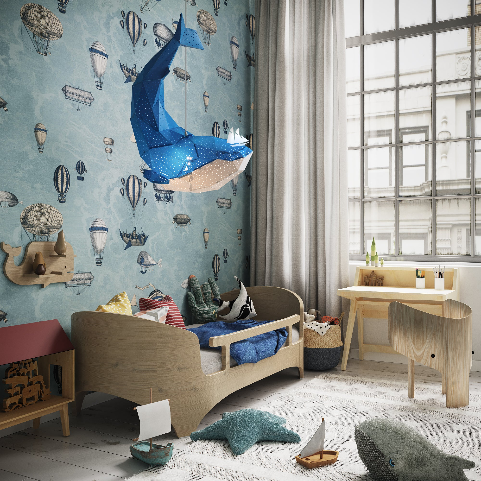 Blue pendant lamp in the form of a whale that hangs in the sea-themed kids'room.