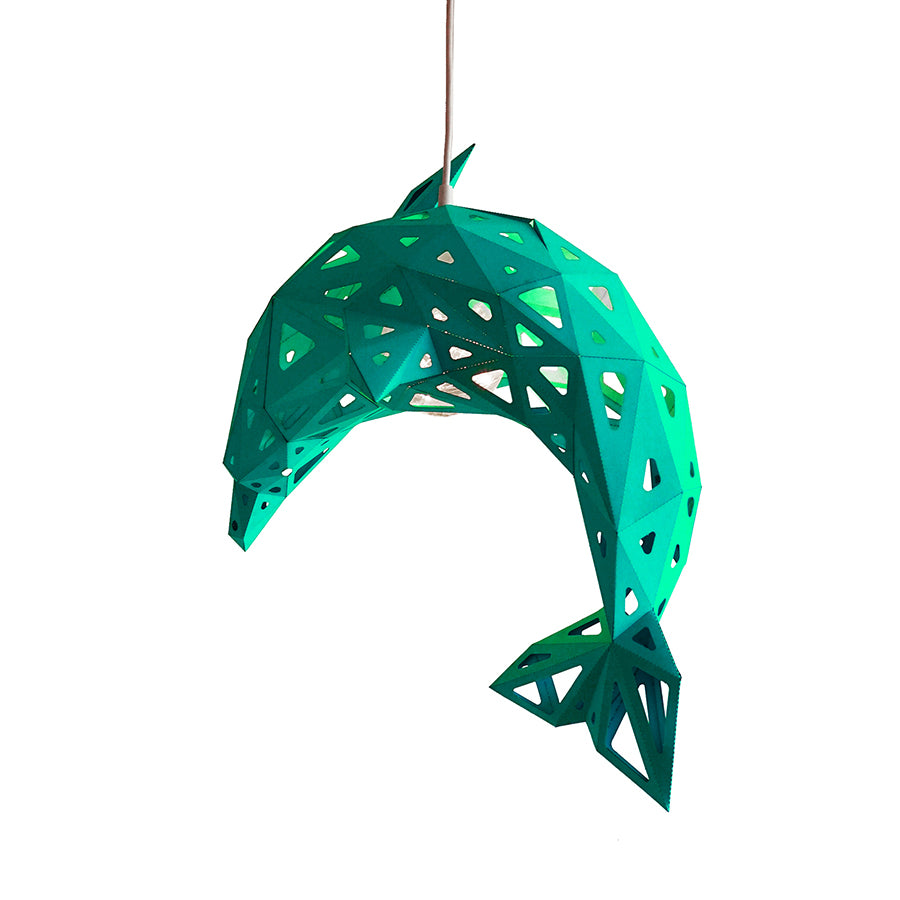 Green DIY pendant paper Dolphin lampshade on white background.