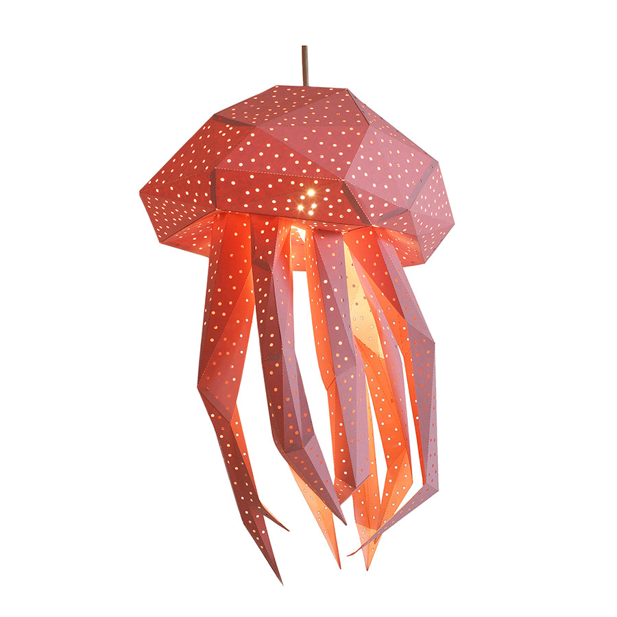 DIY pink papercraft Jellyfish lantern on white background.