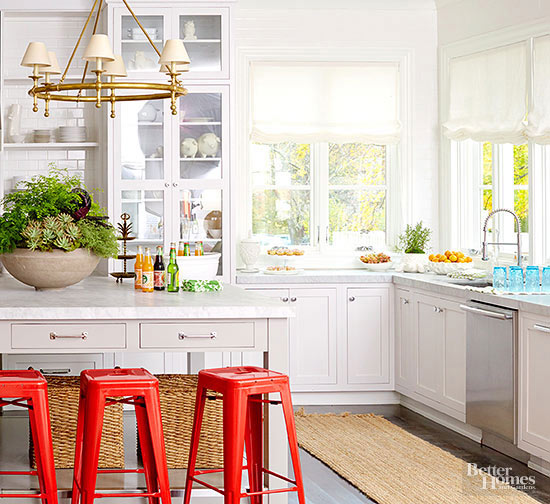 Natural light in white kitchen with pops of color