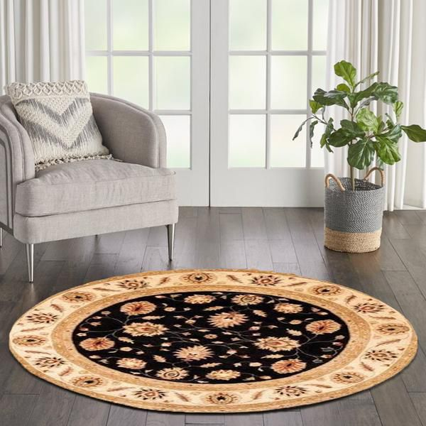 To layer your Round Rug With a Bold Accent rug.