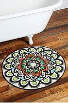 Anthropologie round rug in bathroom