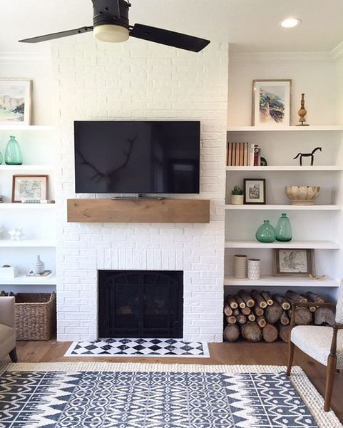 Simple white fireplace and shelves. Minimalist and beautiful!