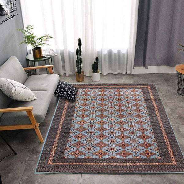 Tip3: Use two rugs to beautify a larger space