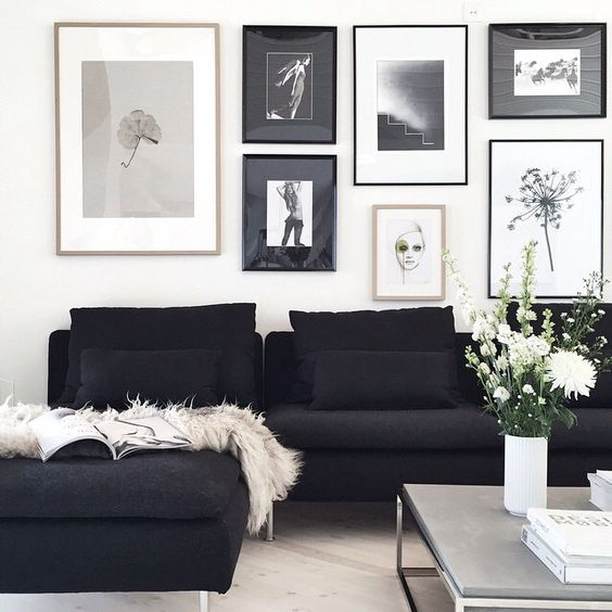 Black and white living room! Black furniture looks especially nice against white walls.