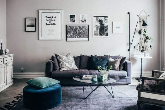 Beautiful soft grey walls and muted furnishings with a pop of colour in the ottoman scandinavian