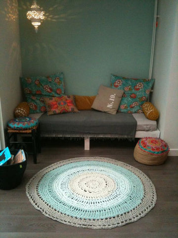 Corner nook with round rug from RugKnots.com