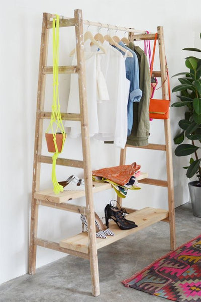 "DIY ladder clothing rack Perfect for clothes that are ""in use"" during the week, and most frequently used shoes. I'd had some pegs/hooks/door knobs on the sides for stuff that doesn't need a hanger.:"