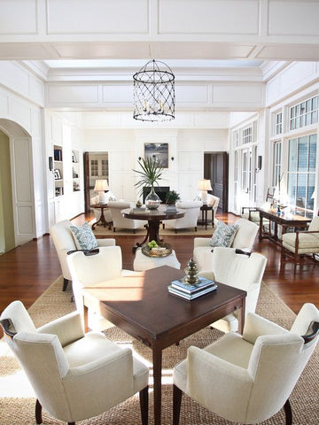 multiple seating area | large windows | hanging pendant lighting: