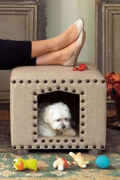 Ottoman Dog Bed. The Ottoman works triple time as an ottoman, end table and seriously stylish dog house! See more pictures.:
