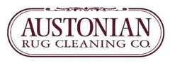 White backdrop with logo saying Austonian rug cleaning company