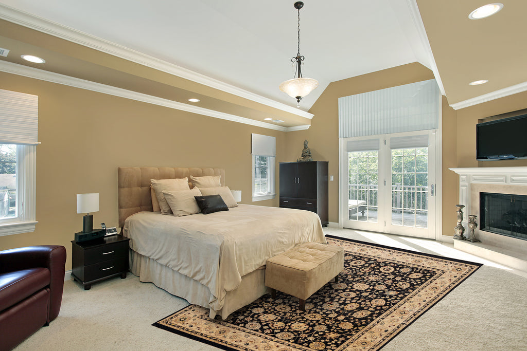 Hand knotted rug: zeigler rug in a bedroom