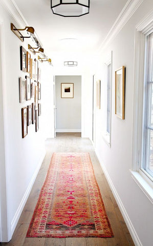 Beautiful oriental rug in a white hallway
