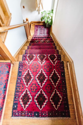 Bokhara runner rug on a wooden staircase