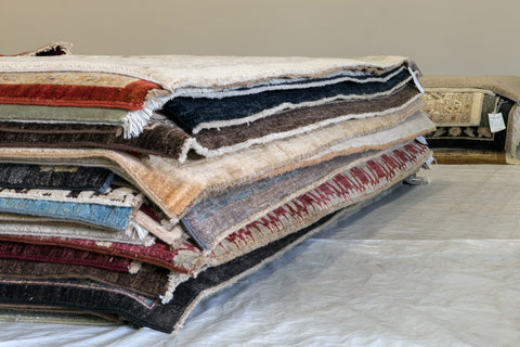Stack of Rugs at RugKnots warehouse