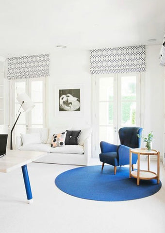 Round blue rug in corner nook of a home