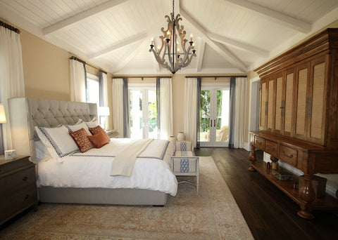 Bedroom With A Large Area Rug Under The Bed