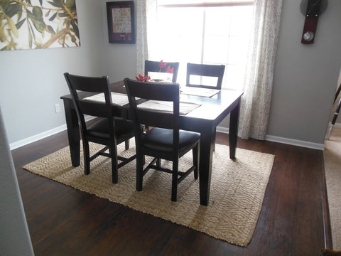 Square area rug under a square dining room table