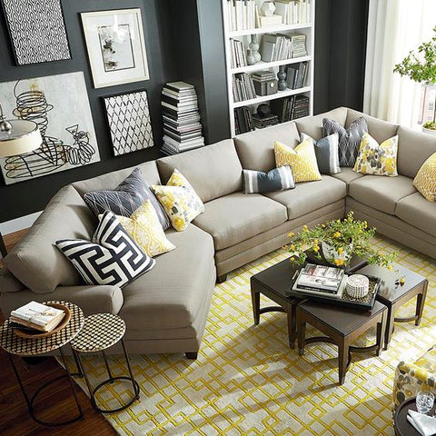 Sectional with large yellow and white area rug