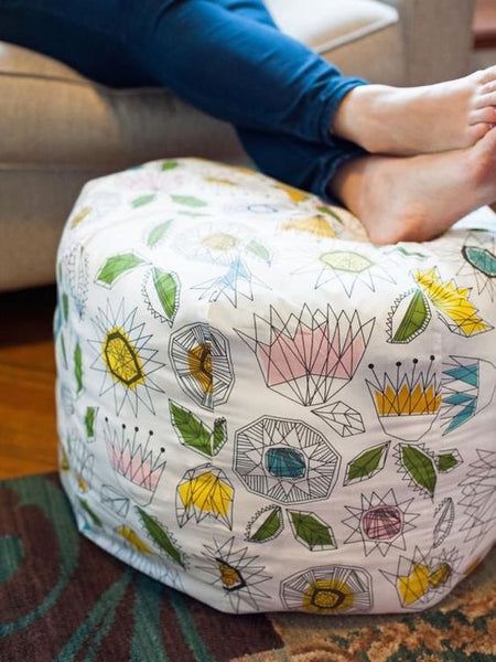 Create your own fabric pouf ottoman with this sewing DIY project.: