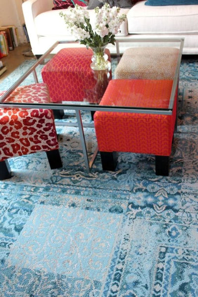 ottomans under glass table: