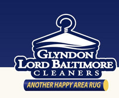Blue and white backdrop with logo saying glydon lord baltimore cleaners