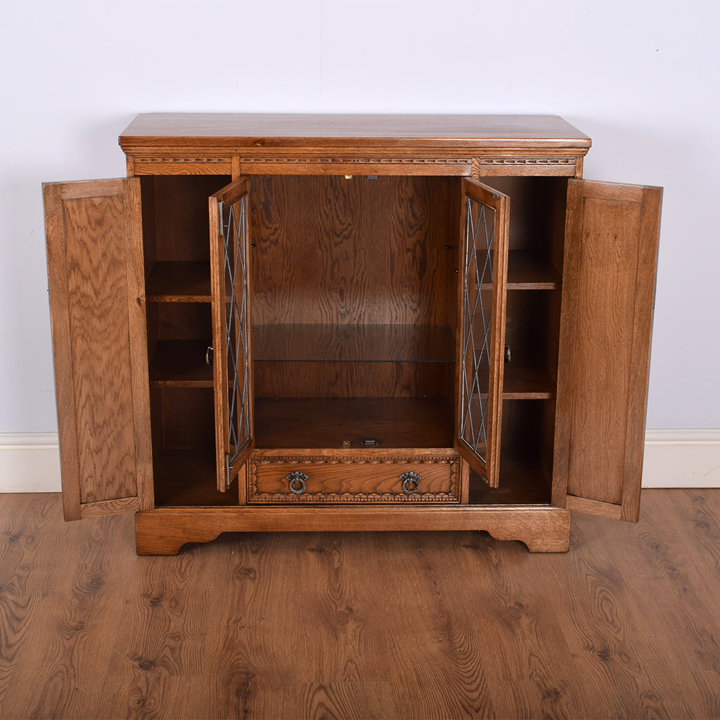 Carved Oak Old Charm Glazed Bookcase