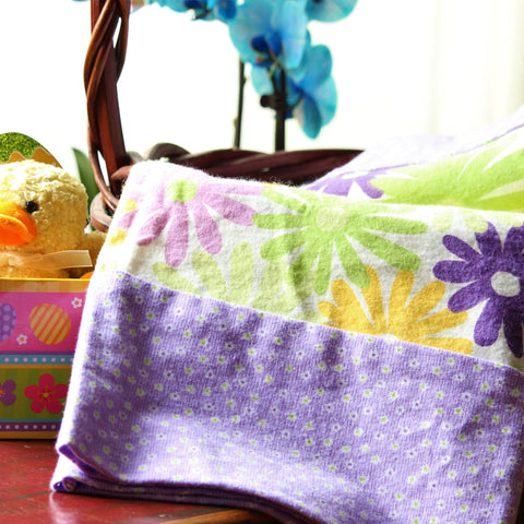 Easter vignette featuring a flannel pillowcase with purple, yellow and lime flowers