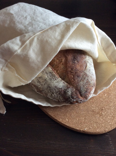 linen bread bag with loaf of bread