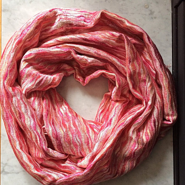 pink and coral subtle wave patterned infinity scarf flatlay image