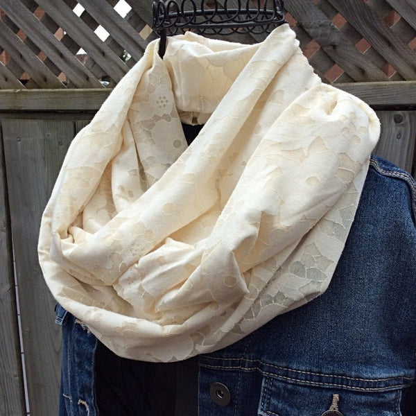 ivory infinity scarf with flower burnout effect worn with jean jacket