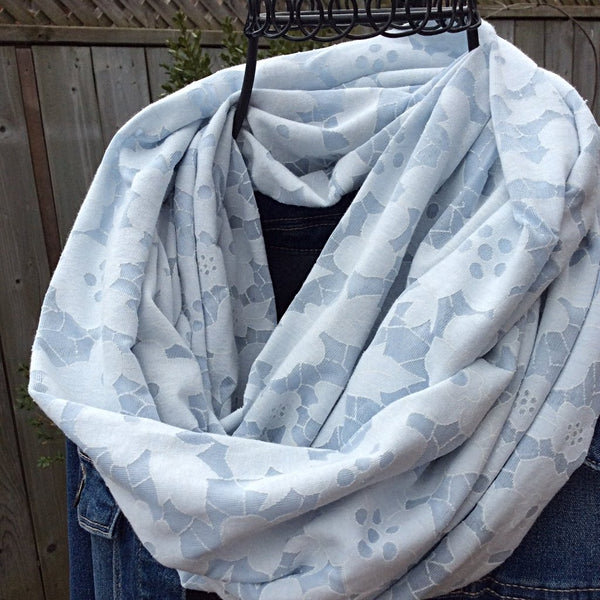 pale blue infinity scarf with floral burnout effect worn with jean jacket