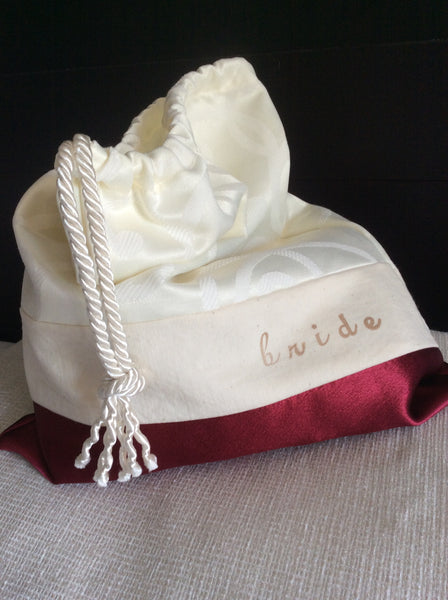 "brocade and satin drawstring bag ink-stamped with ""bride"""