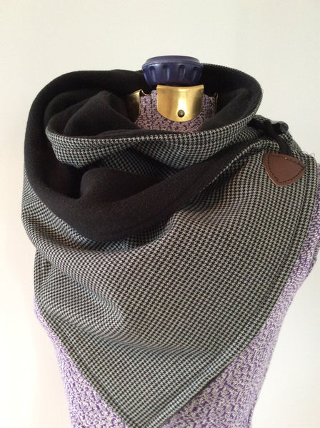 men's grey and black houndstooth and fleece neck wrap on mannequin