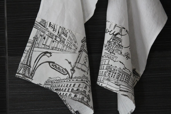 White linen dish towels with black Parisian images, close-up of images